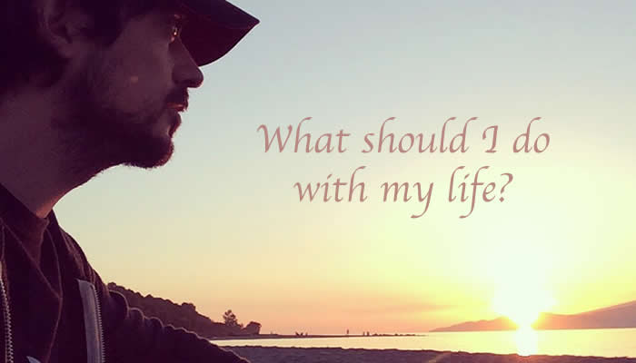 Miguel pondering about his passions at Jericho Beach, in Vancouver