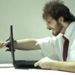 Frustrated-computer-user-punching-through-laptop1