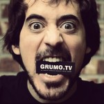 Miguel Hernandez, Founder of Grumo Media chewing on his business card.. nom.. nom!