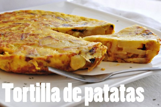 Tortilla de patatas is a Spanish salty yellow pie made of fried ...